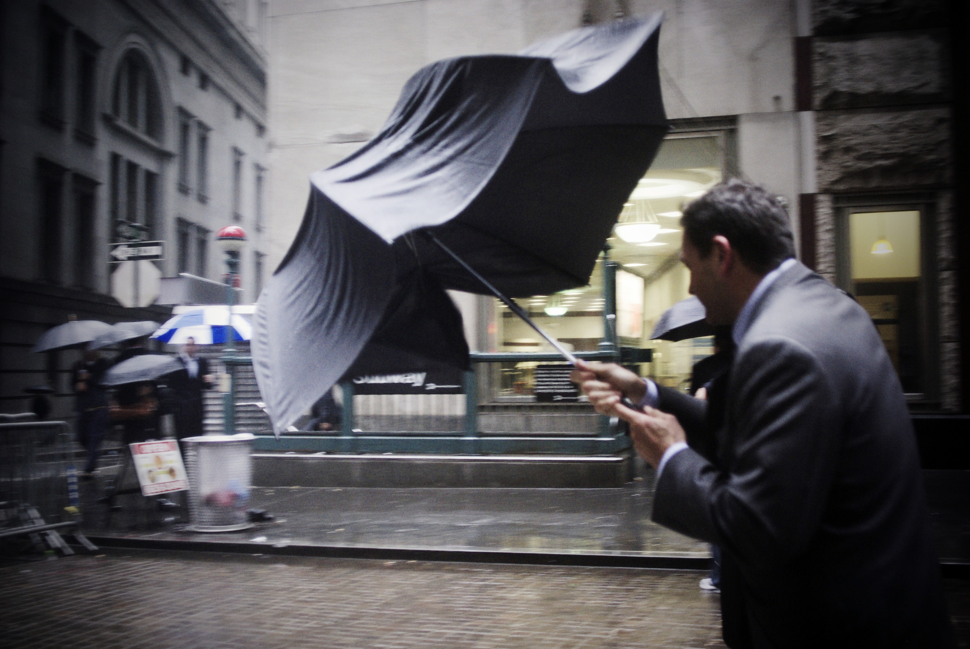 Man-with-ripped-umbrella-Wall-Street-New-York_IGP3591b